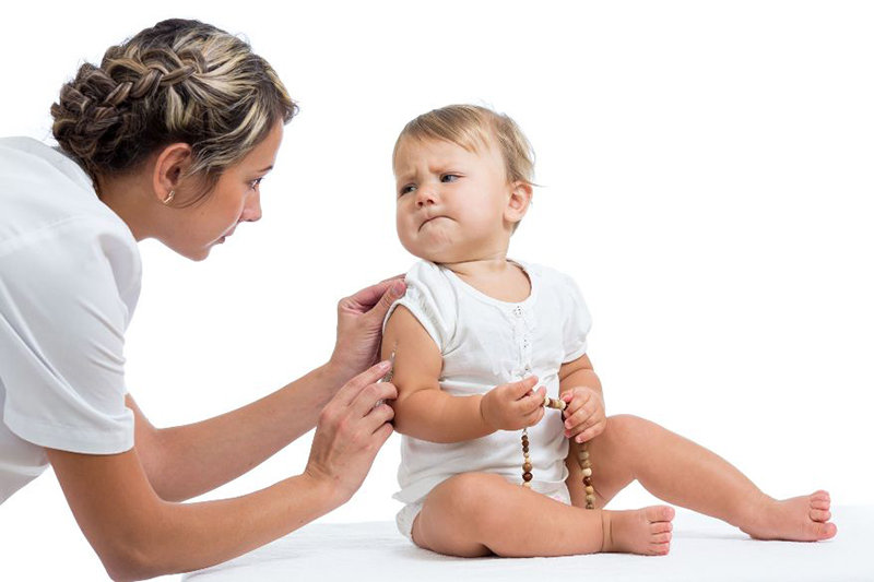 15225875 - doctor vaccinating  crying baby isolated on a white b